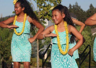 Two Young Ladies dancing Hula